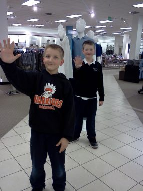 raising a child with PH   Pulmonary Hypertension News   A young Cullen dressed in a dark blue sweater mimics a mannequin in a department store with his brother