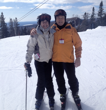 traveling with PH   Pulmonary Hypertension News   Anna and her dad hug each other on the ski slopes when she was in college